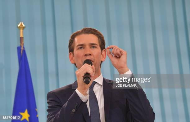 Austria's Foreign Minister and leader of Austria's centreright People's Party Sebastian Kurz speaks to supporters during the party's election event...