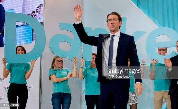 TOPSHOT Austria's Foreign Minister and leader of Austria's centreright People's Party Sebastian Kurz waves to supporters during the party's election...