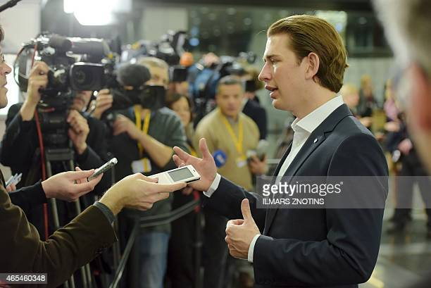 Austria's Foreign Minister Sebastian Kurz talks to journalists during an Informal Meeting of EU Foreign Ministers in Riga Latvia on March 7 2015 AFP...