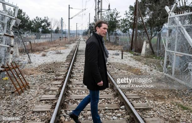 Austria's foreign minister Sebastian Kurz walks on railways as he visits Macedonia's southern border with Greece that has served as European border...