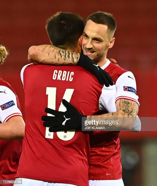 Austria's forward Adrian Grbic celebrates scoring the 2-1 goal with his team-mate Austria's forward Marko Arnautovic during the UEFA Nations League...