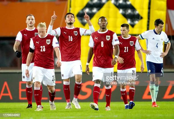 Austria's forward Adrian Grbic celebrates scoring the 2-1 goal with his team-mates during the UEFA Nations League football match Austria v Northern...