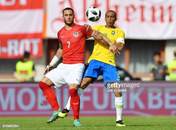 Austria's forward Marko Arnautovic and Brazil's defender Joao Miranda vie for the ball during the international friendly footbal match Austria vs...