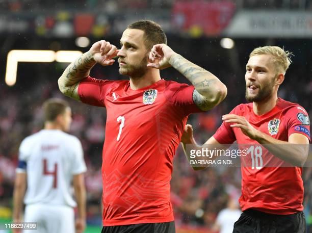 Austria's Forward Marko Arnautovic celebrate scoring during the UEFA Euro 2020 qualification football match between Austria and Latvia in Salzburg...