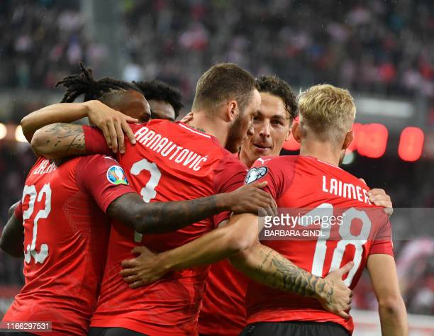 Austria's Forward Marko Arnautovic celebrate scoring with his teammates during the UEFA Euro 2020 qualification football match between Austria and...