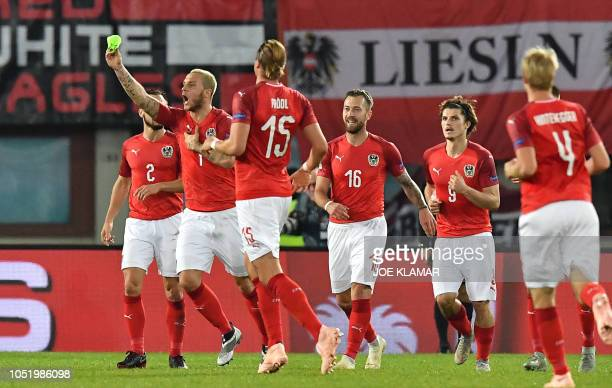 Austria's forward Marko Arnautovic celebrates scoring the opening goal with his teammates during the UEFA Nations League Group B football match...