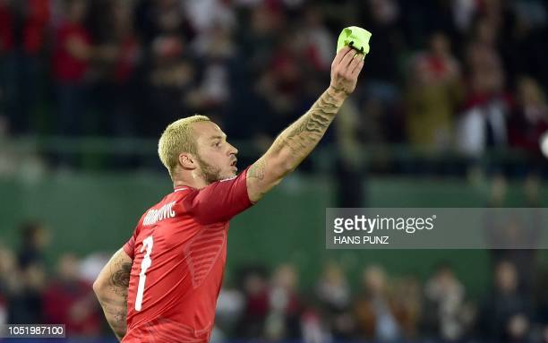 Austria's forward Marko Arnautovic celebrates scoring the opening goal during the UEFA Nations League Group B football match Austria v Northern...
