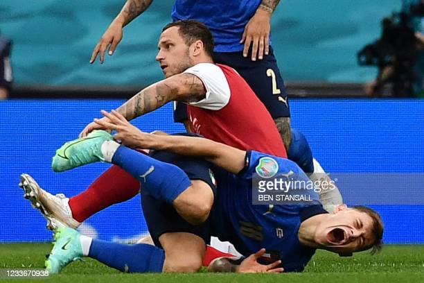 Austria's forward Marko Arnautovic fouls Italy's midfielder Nicolo Barella during the UEFA EURO 2020 round of 16 football match between Italy and...
