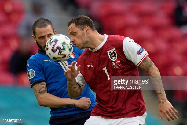 Austria's forward Marko Arnautovic is marked by Italy's defender Leonardo Bonucci during the UEFA EURO 2020 round of 16 football match between Italy...