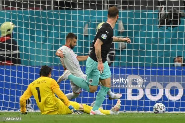 Austria's forward Marko Arnautovic scores his team's third goal during the UEFA EURO 2020 Group C football match between Austria and North Macedonia...