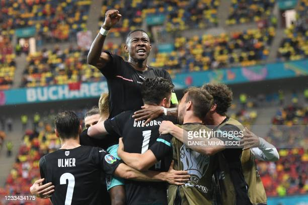 Austria's forward Michael Gregoritsch celebrates scoring his team's second goal with his team-mates including Austria's defender David Alaba during...