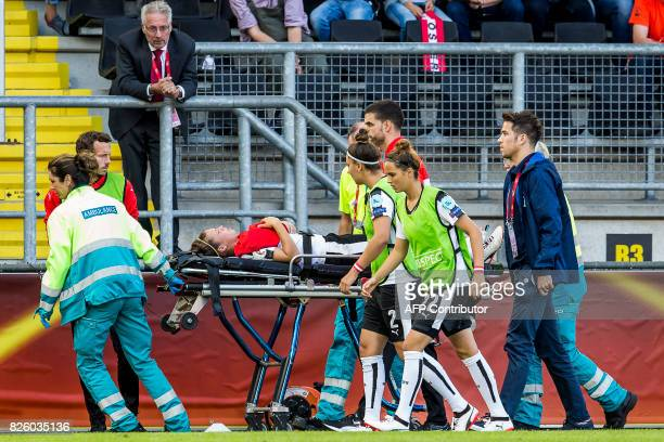 Austria's forward Nicole Billa is brought off the pitch in a stretcher during the UEFA Womens Euro 2017 football tournament semifinal match between...