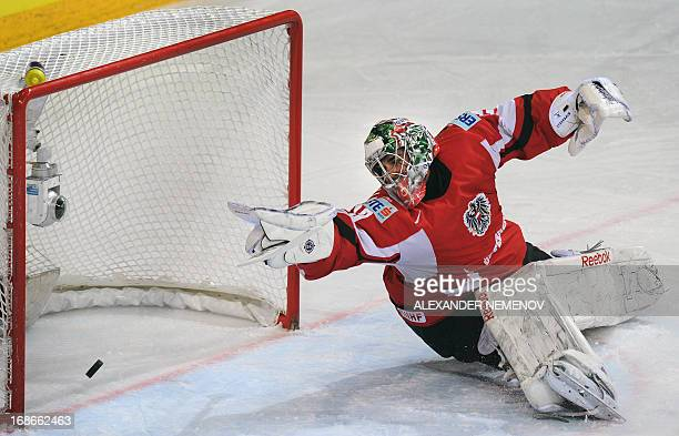 Austria's goalkeeper Bernard Starkbaum lets the puck into his net during a preliminary round game Austria vs Russia of the IIHF International Ice...