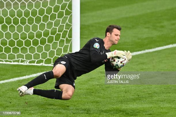 Austria's goalkeeper Daniel Bachmann makes a save during the UEFA EURO 2020 round of 16 football match between Italy and Austria at Wembley Stadium...
