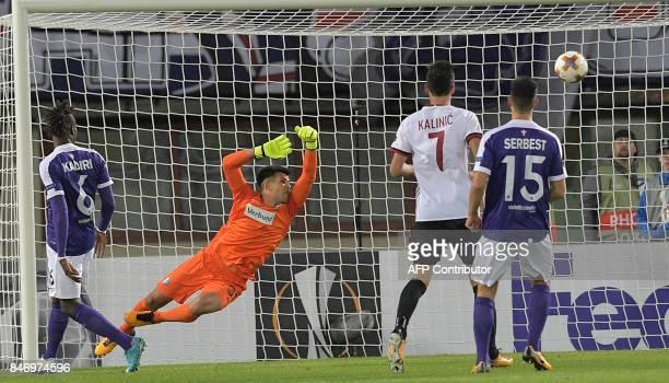 Austria's goalkeeper Osman Hadzikic fails to save as Milan's Turkish midfielder Hakan Calhanoglu scores to 10 during the group D UEFA Europa League...