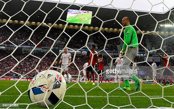 Austria's goalkeeper Robert Almer reacts after Hungary's forward Adam Szalai scored during the Euro 2016 group F football match between Hungary and...