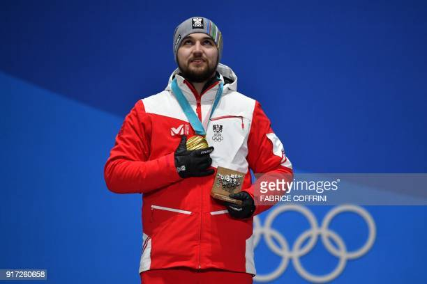 Austria's gold medallist David Gleirscher poses on the podium during the medal ceremony for the men's luge singles at the Pyeongchang Medals Plaza...