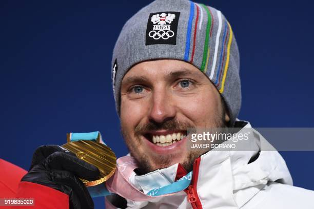 TOPSHOT Austria's gold medallist Marcel Hirscher poses on the podium during the medal ceremony for the alpine skiing men's giant slalom at the...