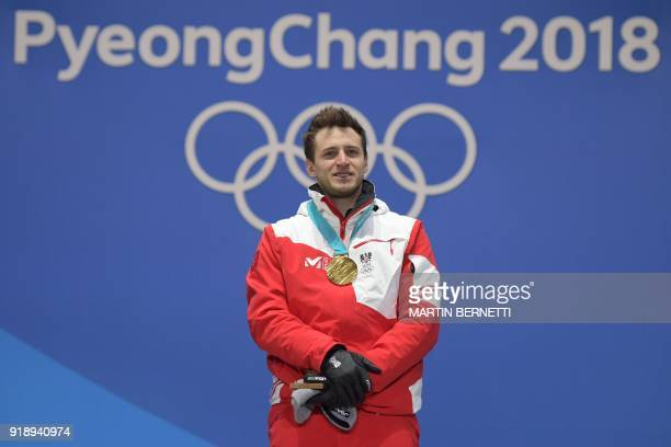 Austria's gold medallist Matthias Mayer poses on the podium during the medal ceremony for the alpine skiing Men's SuperG at the Pyeongchang Medals...