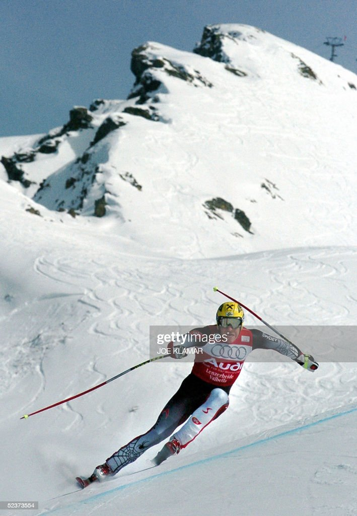 Austria's Hermann Maier competes during the men's Ski World Cup final super-G race in Lenzerheide, 11 March 2005. US Bode Miller won the race and the globe ex-aeqo with his teammate Daron Rahlves, Austria's Stephan Goergl ranked second and Lichtenstein's Marco Buechel ranked third. Maier ranked 9th place.