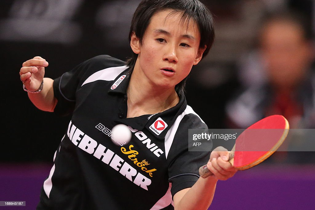 Austria's Jia Liu plays against North Korea's Myong Sun Ri on May 17, 2013 in Paris, during the fourth round of Women's Singles of the World Table Tennis Championships.