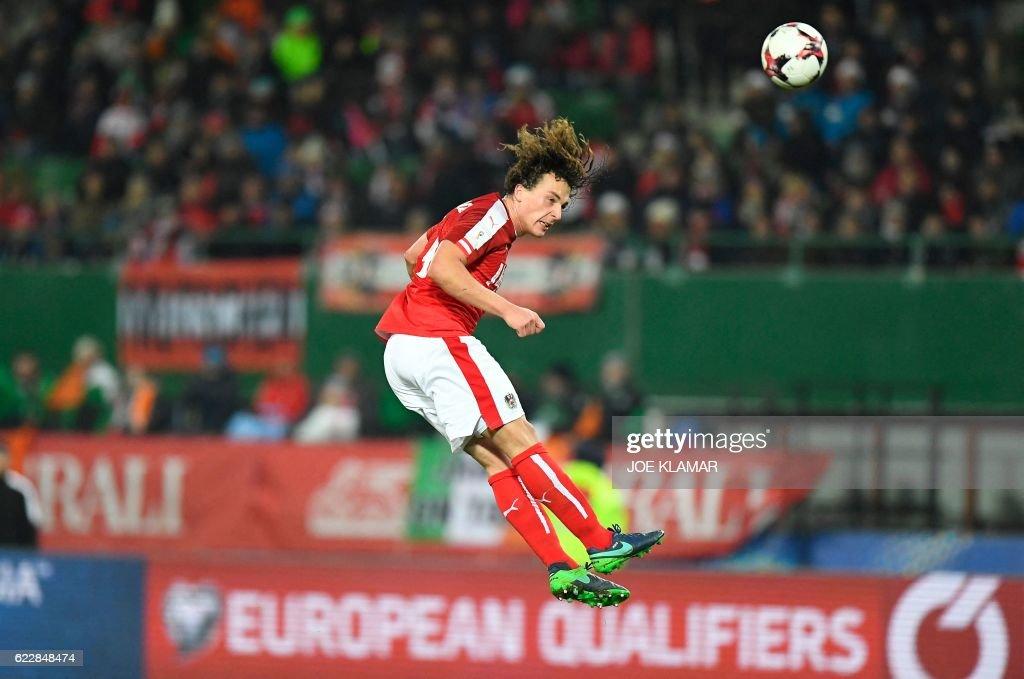 Austria's Julian Baumgartlinger heads a ball during the World Cup 2018 qualification football match between Austria and Ireland in Vienna on November 12, 2016. / AFP / JOE