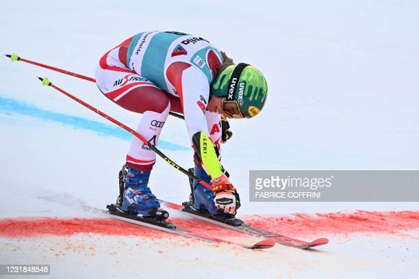 Austria's Katharina Liensberger crosses the finish line after competing in the second run of the Women's Giant Slalom event during the FIS Alpine ski...