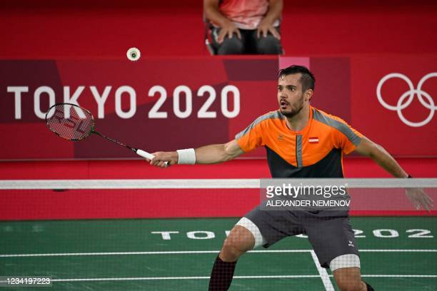 Austria's Luka Wraber hits a shot to Finland's Kalle Koljonen in their men's singles badminton group stage match during the Tokyo 2020 Olympic Games...