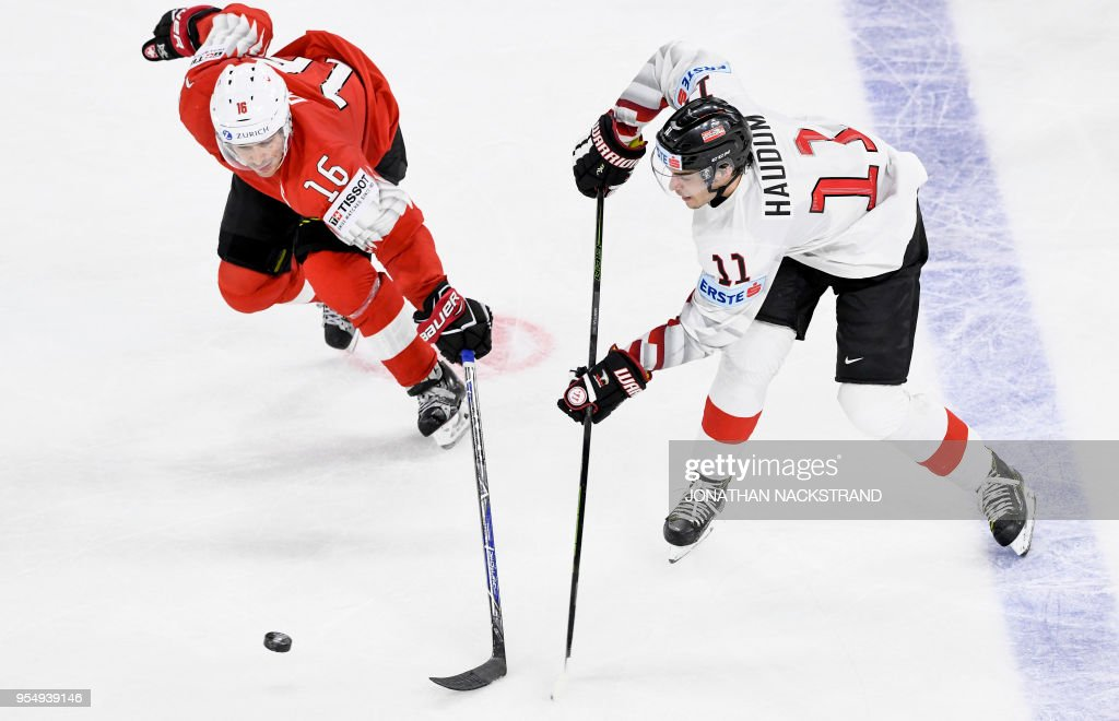 Austria's Lukas Haudum (R) vies with Switzerland's Raphael Diaz during the group A match Switzerland vs Austria of the 2018 IIHF Ice Hockey World Championship at the Royal Arena in Copenhagen, Denmark, on May 5, 2018.