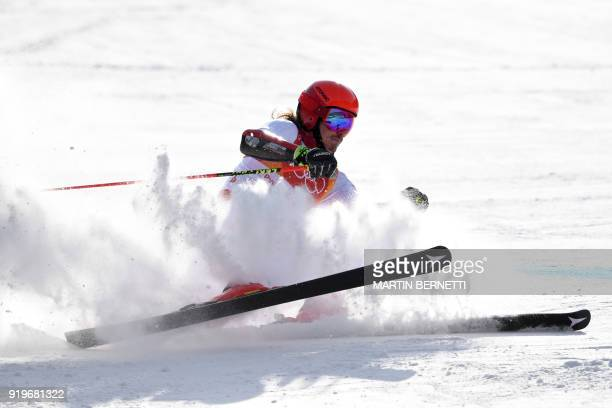 Austria's Manuel Feller falls just before crossing the finish line while competing in the Men's Giant Slalom at the Jeongseon Alpine Center during...