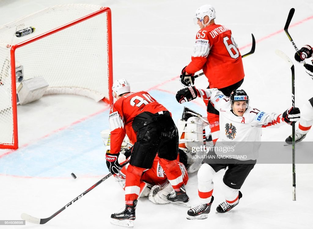Austria's Manuel Ganahl (R) celebrates after scoring a goal during the group A match Switzerland vs Austria of the 2018 IIHF Ice Hockey World Championship at the Royal Arena in Copenhagen, Denmark, on May 5, 2018.