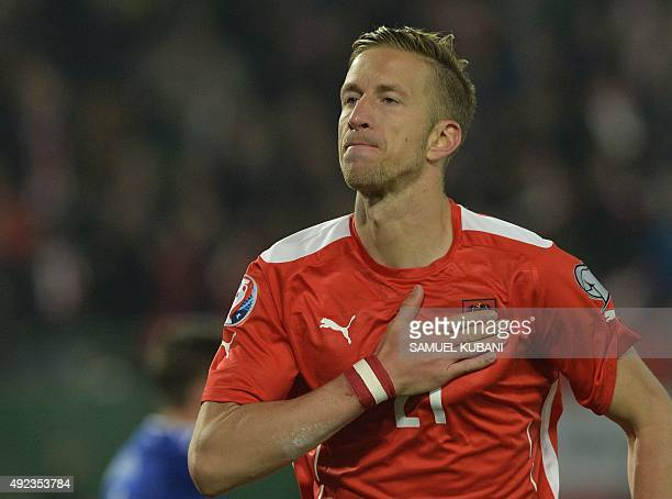 Austria's Marc Janko celebrates after scoring during the Euro 2016 Group G qualifying football match between Austria and Liechtenstein at the...