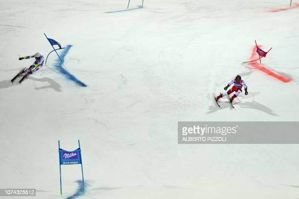 Austria's Marcel Hirscher and France's Thibaut Favrot compete in the Big Final of the FIS Alpine World Cup Men's Parallel Giant Slalom nightrace on...