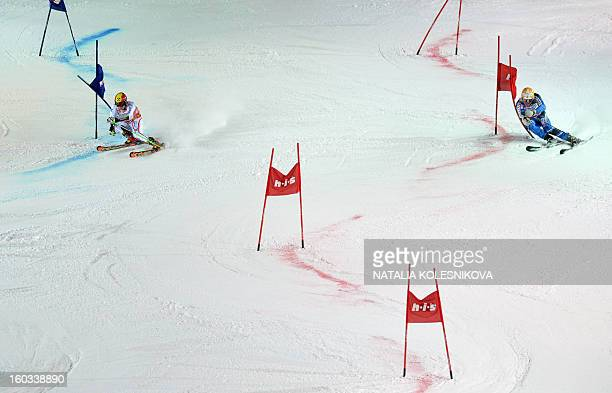 Austria's Marcel Hirscher and Sweden's Andre Myhrer compete at the FIS Ski World Cup Parallel Slalom city event's final in Moscow on January 29 2013...