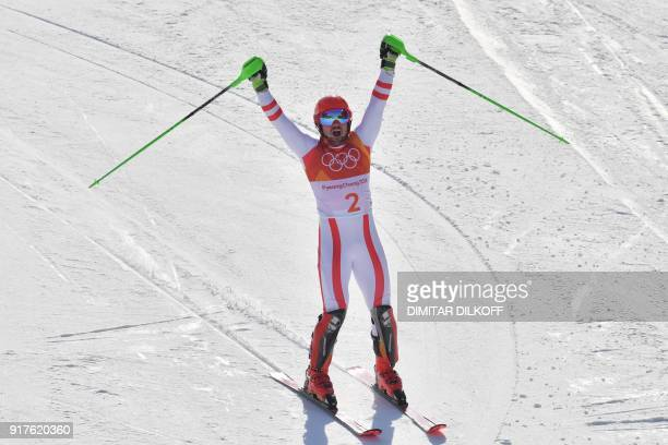 Austria's Marcel Hirscher celebrates after crossing the finish line of the Men's Alpine Combined Slalom at the Jeongseon Alpine Center during the...