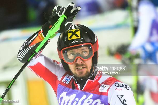 Austria's Marcel Hirscher celebrates after winning the FIS Alpine World Cup Men's Parallel Giant Slalom nightrace on December 17 2018 in Alta Badia
