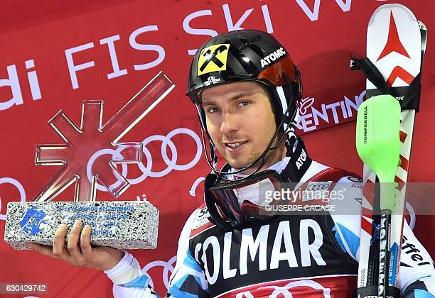 Austria's Marcel Hirscher celebrates his second place on the podium of the Men's Slalom during the FIS Alpine World Cup on December 22 in Madonna di...