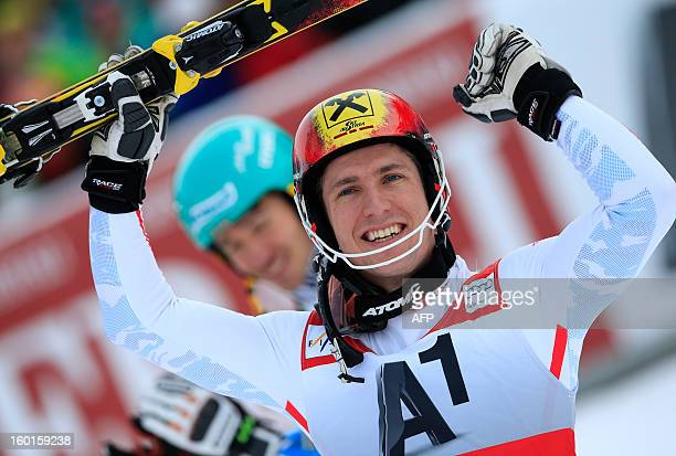 Austria's Marcel Hirscher celebrates next to Germany's Felix Neureuther after competing at the second run of the FIS World Cup men's slalom race on...