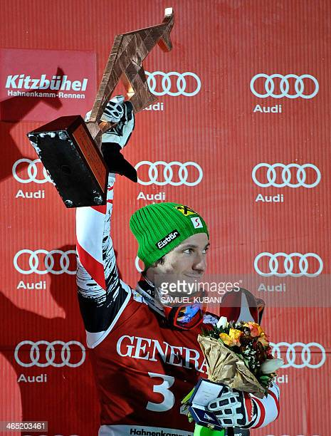Austria's Marcel Hirscher celebrates on podium his third place after competing on January 26 2014 in the FIS men's Alpine ski World Cup Super...