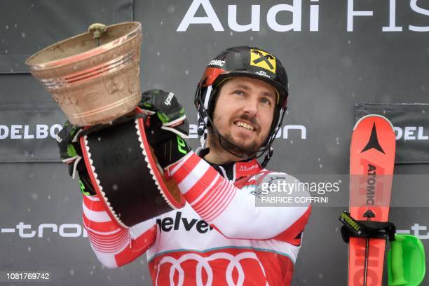 Austria's Marcel Hirscher celebrates on the podium after winning the Men's slalom race at the FIS Alpine Skiing World Cup on January 13 2019 in...