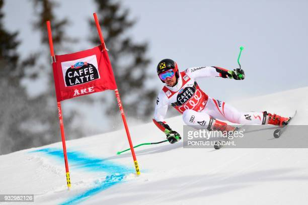 Austria's Marcel Hirscher competes during the men's giant slalom at the alpine ski World Cup finals in Are, on March 17, 2018. / AFP PHOTO / TT NEWS...