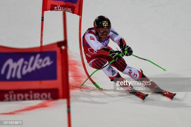 Austria's Marcel Hirscher competes in the 1/8th final of the FIS Alpine World Cup Men's Parallel Giant Slalom nightrace on December 17, 2018 in Alta...