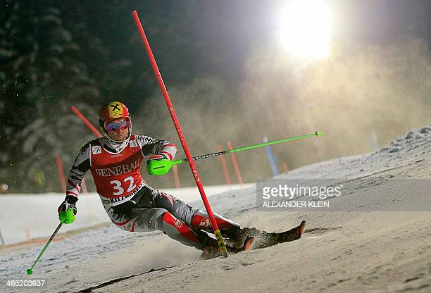 Austria's Marcel Hirscher competes on January 26 2014 in the FIS men's Alpine ski World Cup Super Combined race in Kitzbuehel France's Alexis...