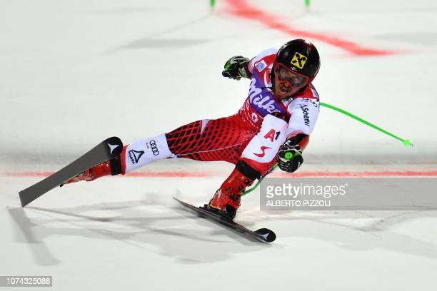 Austria's Marcel Hirscher crosses the finish line of the Bif Final to win the FIS Alpine World Cup Men's Parallel Giant Slalom nightrace on December...