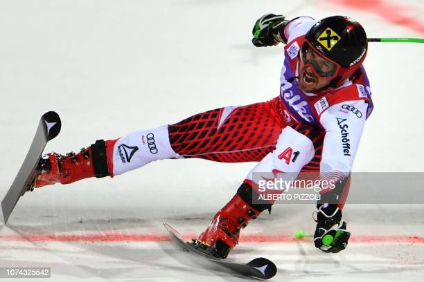TOPSHOT Austria's Marcel Hirscher crosses the finish line to win the FIS Alpine World Cup Men's Parallel Giant Slalom nightrace on December 17 2018...