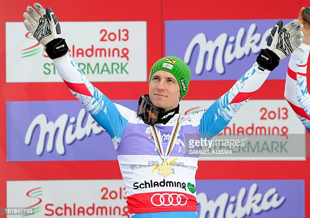 Austria's Marcel Hirscher poses with his gold medal on the podium after winning the men's slalom at the 2013 Ski World Championships in Schladming...