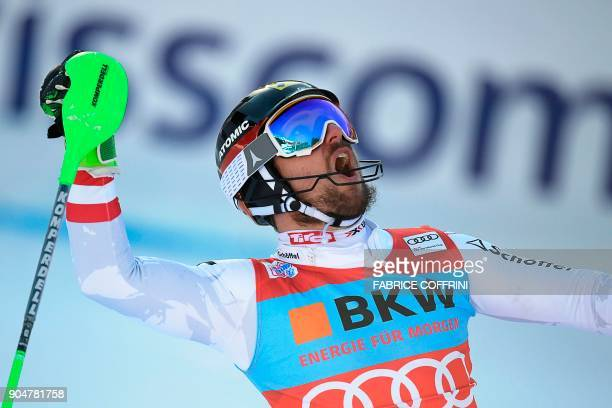 Austria's Marcel Hirscher reacts in the finish area after the second run of the men's Slalom race at the FIS Alpine Skiing World Cup in Wengen on...