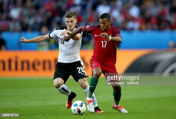 Austria's Marcel Sabitzer and Portugal's Nani battle for the ball.