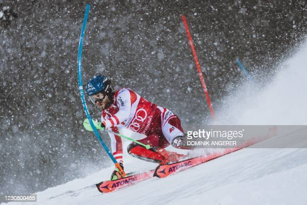 Austria's Marco Schwarz competes during the first run of the men's Slalom event at the FIS Alpine Ski World Cup in Schladming, Austria on January 26,...