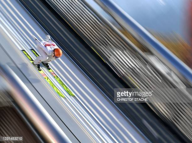 Austria's Marita Kramer slips in the inrun of the normal hill during the trial jump of the Mixed Team HS106 hill jumping event at the FIS Nordic Ski...